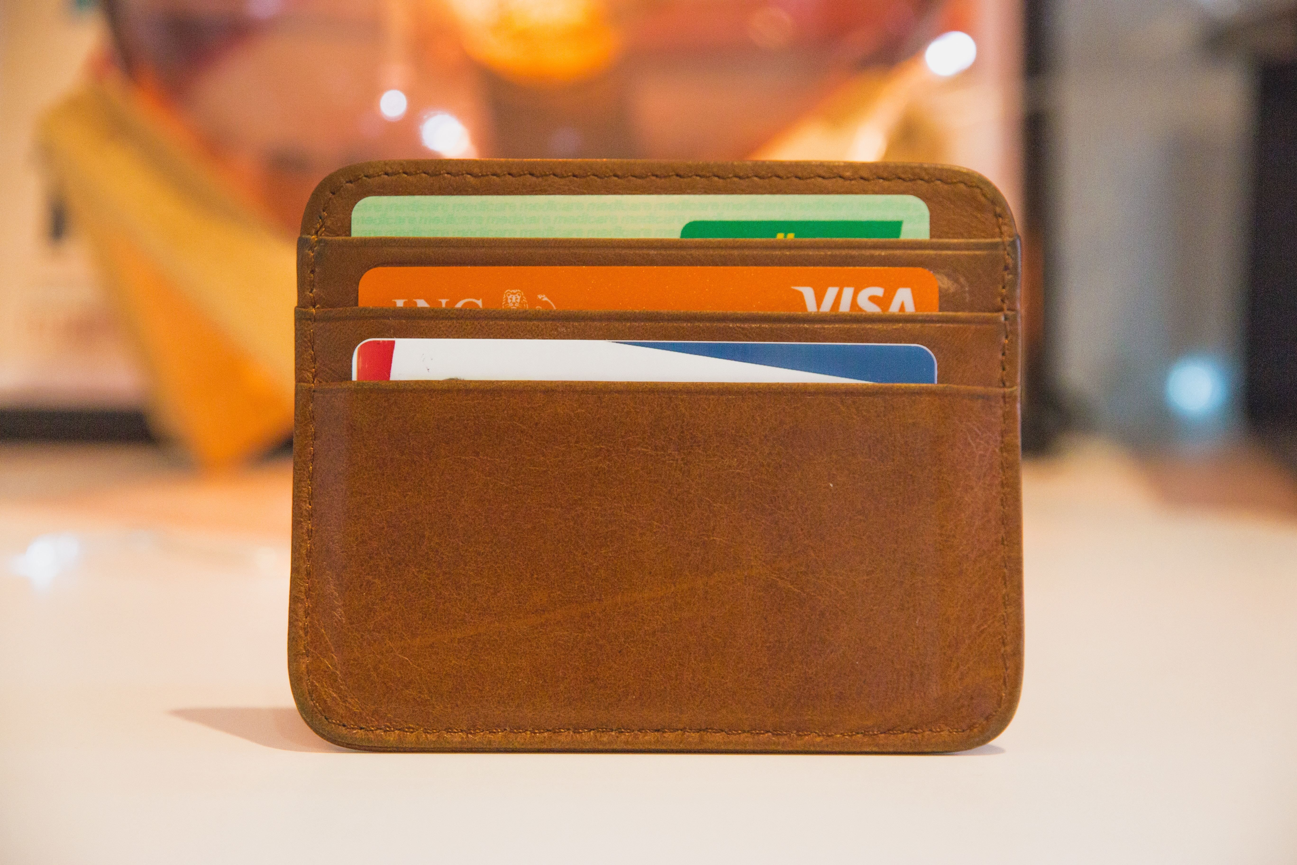 Photo of a credit card wallet with three credit cards.