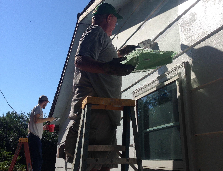 Volunteers paint home