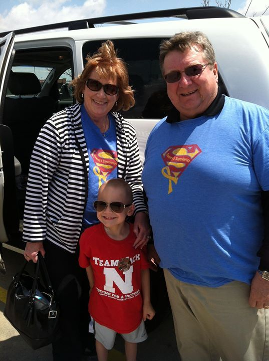 Grandpa John and Grandma Marlene with the Superhero. Do you even recognize him?!?