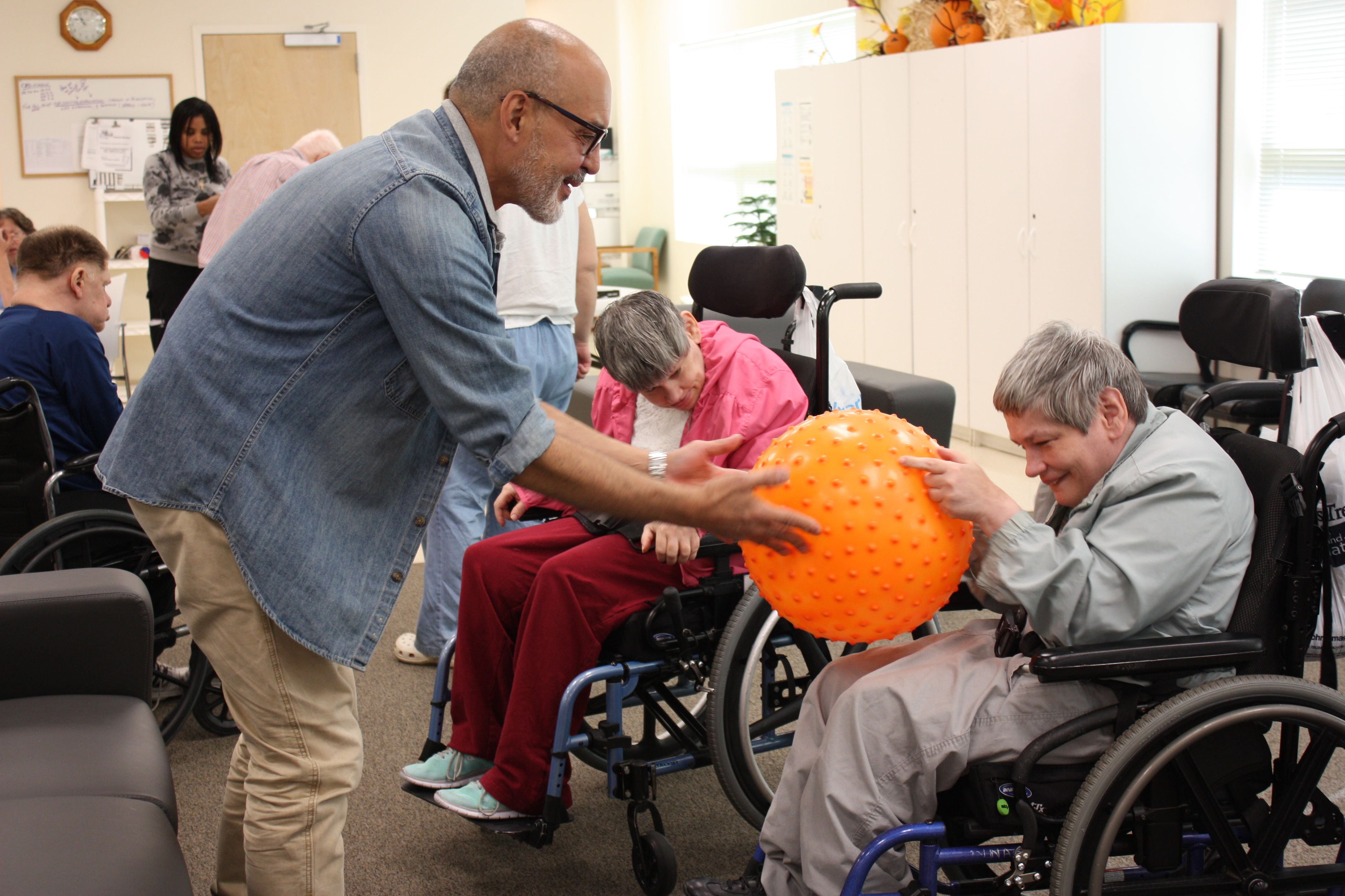 Manager, Mel Santiago provides sensory experience for a participant in the Shore Program.