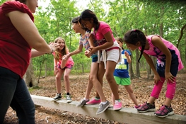 girls_on_balance_beam_at_camp