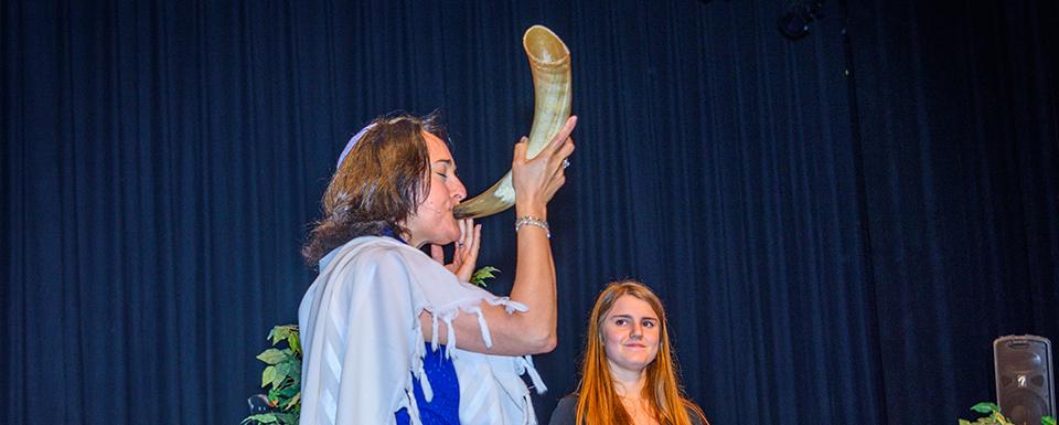 Woman playing the shofar
