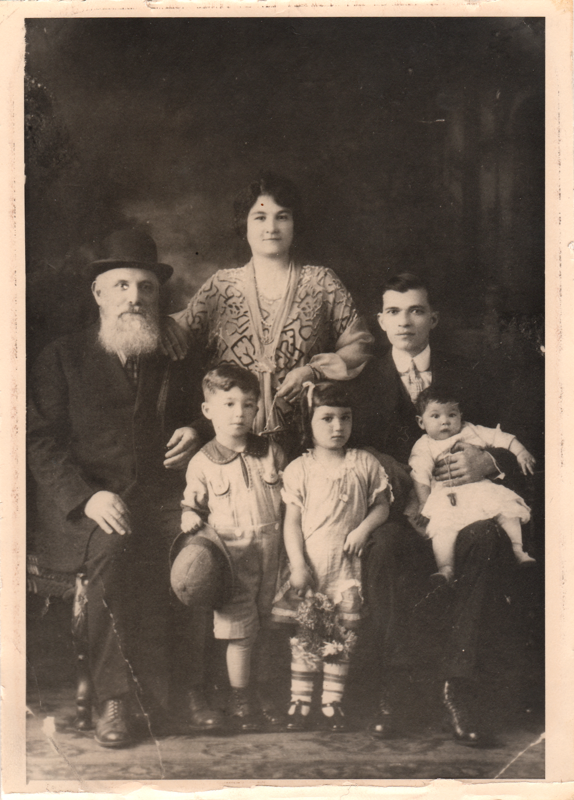 Grandfather Yosef, mother Dona, father Judah, brother Sam, Becky, and sister Nellie.