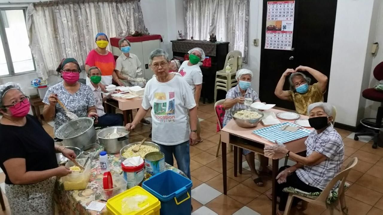 MMS in the Philippines assist with preparing food to deliver in their community.
