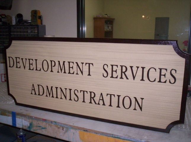 F15558 - Carved, Sandblasted, Wood-Grain HDU Sign for Development Services Administration