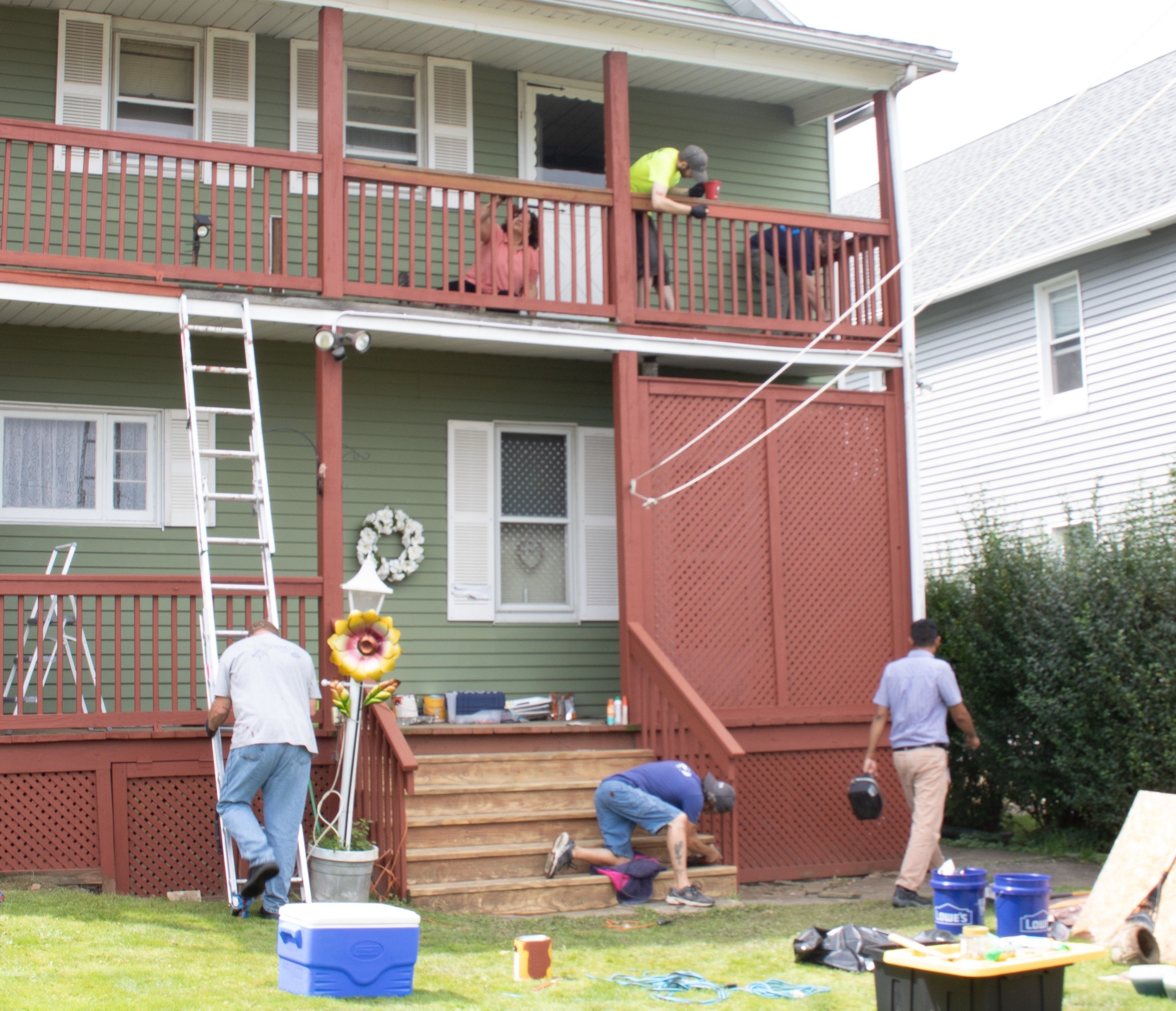 Yardwork being performed on a house.