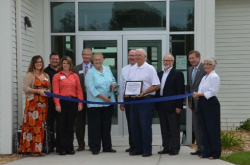 Judy Jasper cuts the ribbon for the Educational Center