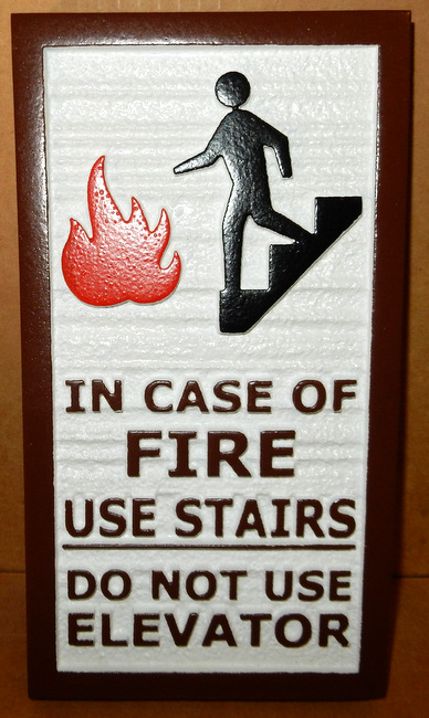 "KA20626 - Carved HDU (or Wood) Sign ""In Case of Fire Use Stairs"" ""Do Not Use Elevator,"" Carved Image of Fire and Man on Stairs"