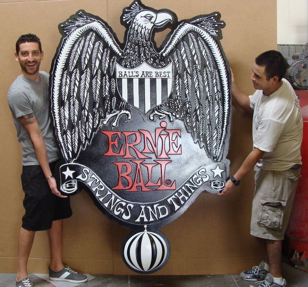 """S28051 - Entrance Sign for """"Ernie Ball"""" Retail Store with Carved 3-D Bas-Relief Carved Eagle and Striped Ball"""
