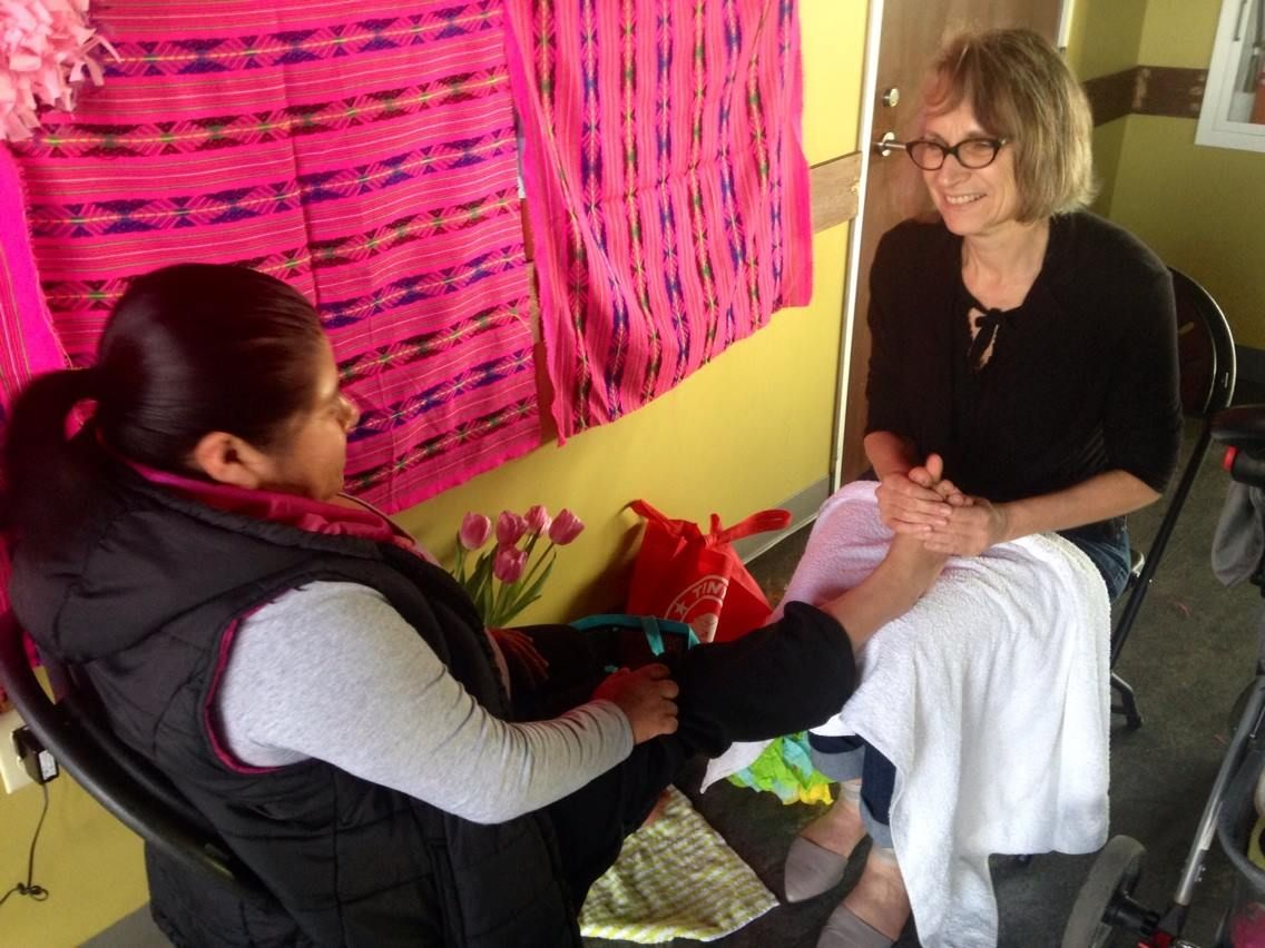 Hilary Stern and Flora Gaytán at Casa Latina during women's spa day for immigrant domestic workers in celebration of International Women's Day, March 2015.  (Photo courtesy Emily Gaggia)