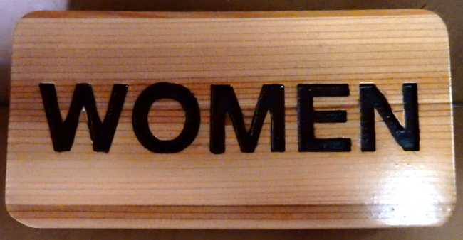 "GB16793 - Carved, Wood Grain Pattern, HDU Sign for ""Women"" (Women's Room)"