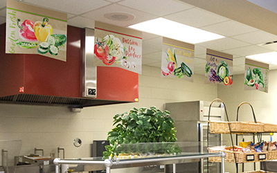 5 food banners hanging in school serving line, watercolor style