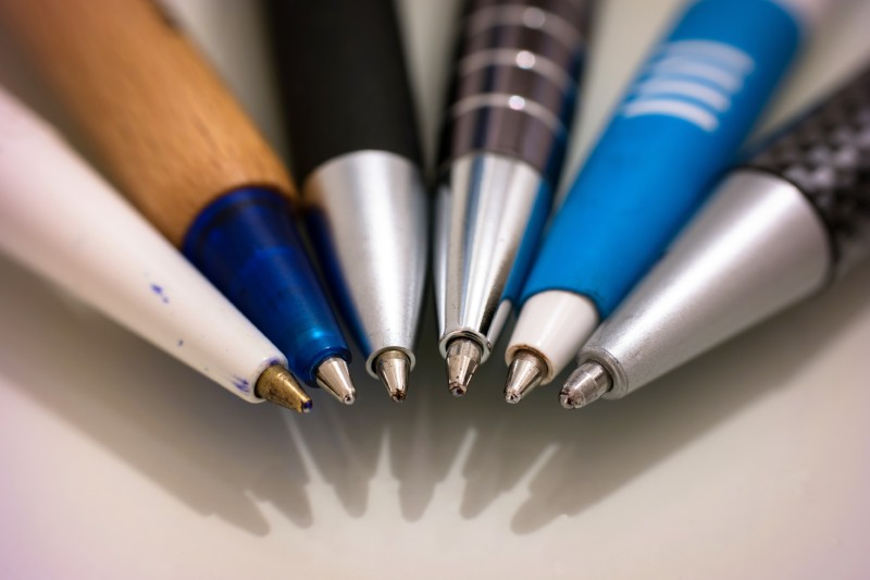 Variety of pens arranged in a semi-circle