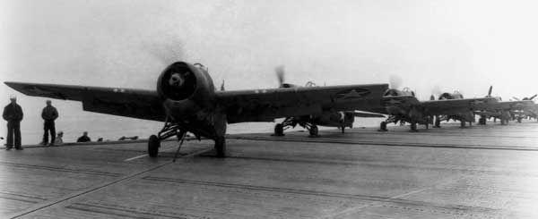 Grumman F4F Wildcats preparing for takeoff from the USS Long Island, 1942.