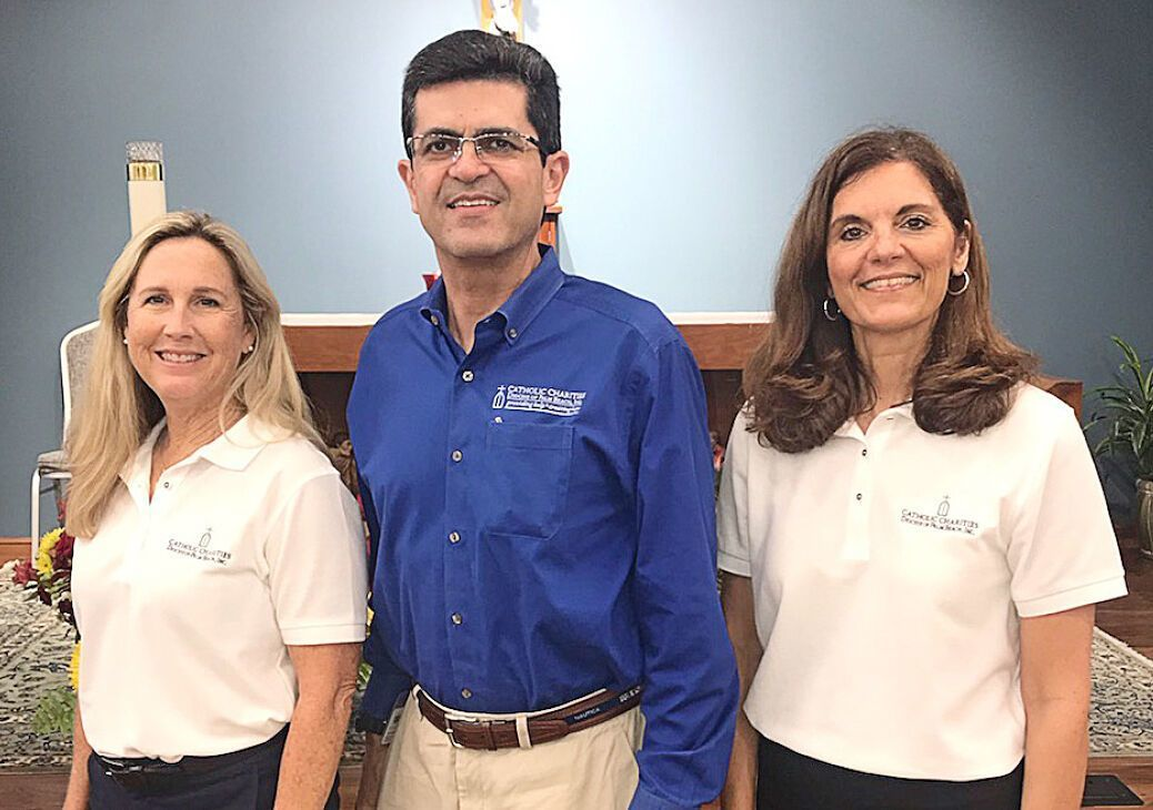 Frankie Chevere, CEO of Catholic Charities of the Diocese of Palm Beach, poses for a photo with Deanna Herbst-Hoosac, Catholic Charities ambassador from St. Ignatius of Loyola and Donna Pearson, director of parish social ministry at Catholic Charities.