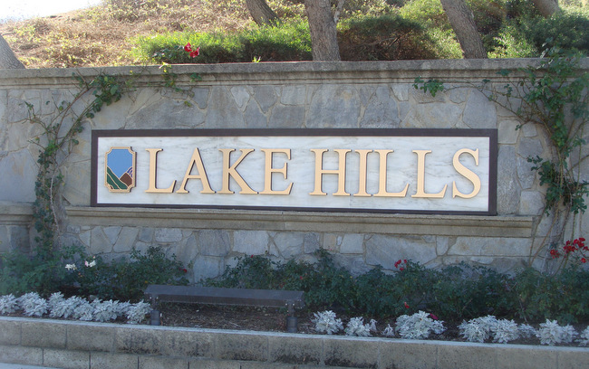 K20030 - Stone Monument Sign with Gold Letters and Carved Logo Scene