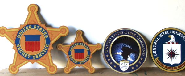 U30382 - Wall Plaques of US Marshall Badges, Cyber Command, and CIA