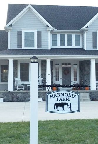 P25231 - Carved HDU Farm Sign Shown in P25240 Hung from a Cast Iron Bracket Mounted on Lighted Wood Post