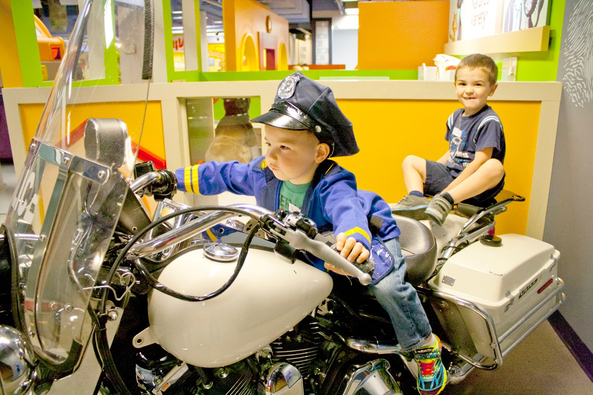 Kids dressed as police officers on motorcycle