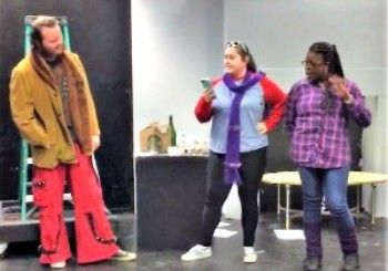 Three students performing in theater class