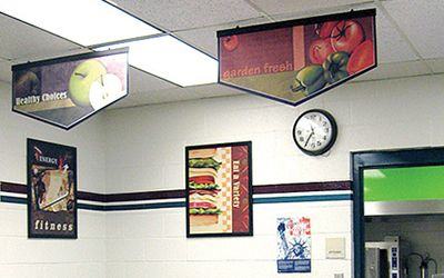 School lunch line with 2 banners and 2 food posters, custom signs, school banners