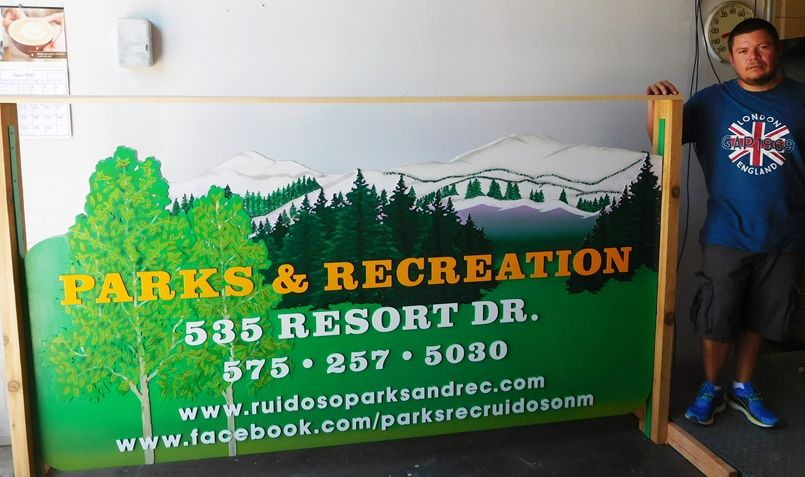 M5009 - Carved Multi-Level HDU Entrance Sign for the Ruidosa Village Parks & Recreation Department, with Mountain Scene