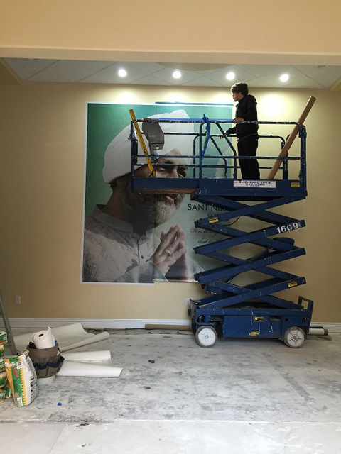 How are wall murals installed