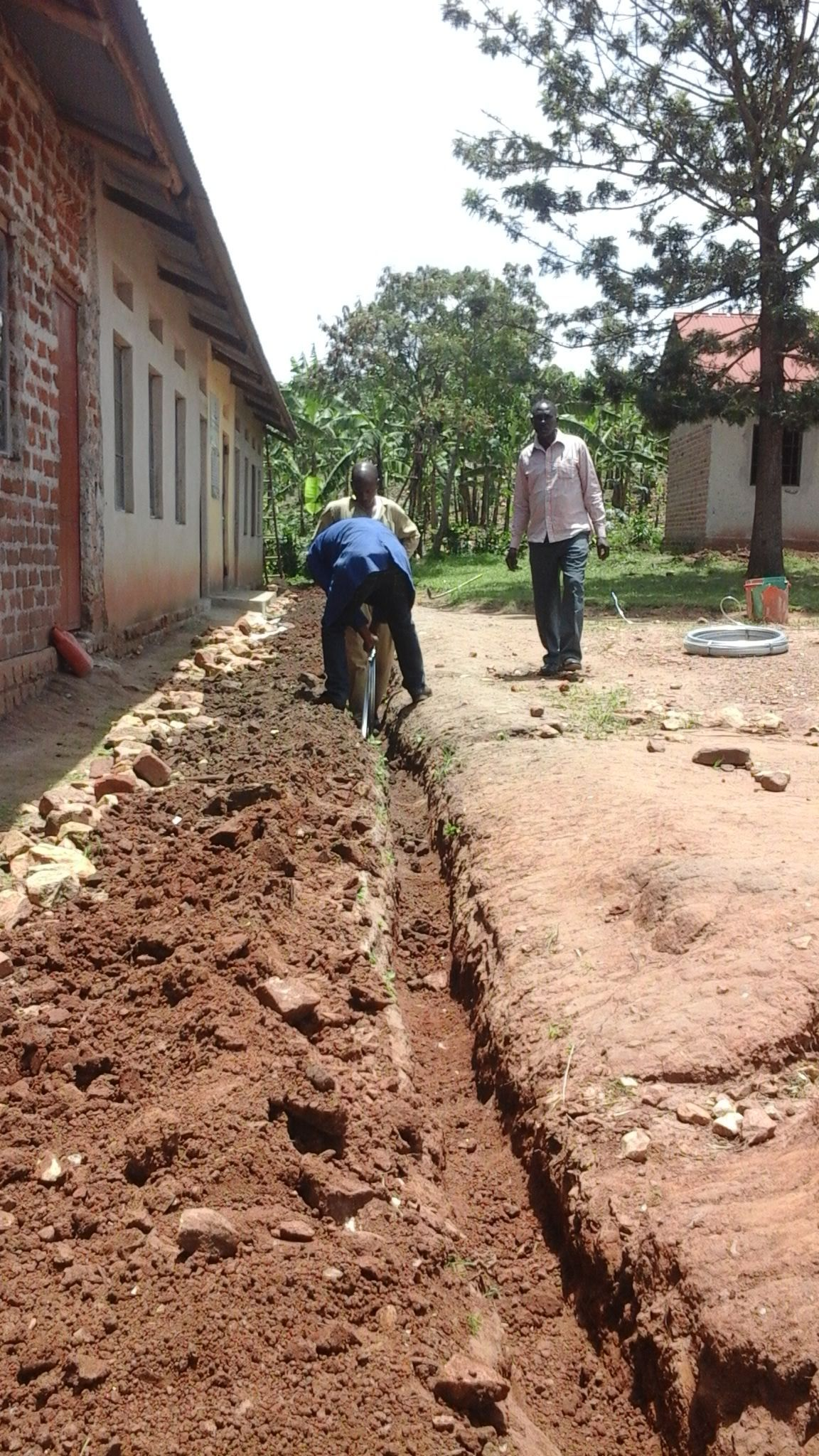 Community-ACLENet Partnership -- Our installer staff work with parent vounteers who dig the trenching for the earthing/grounding rings that surround every building