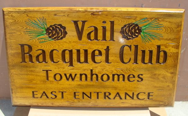K20160 - Engraved Wood-Look HDU Entrance Sign to Vail Racquet Club Townhomes, with Pinecones