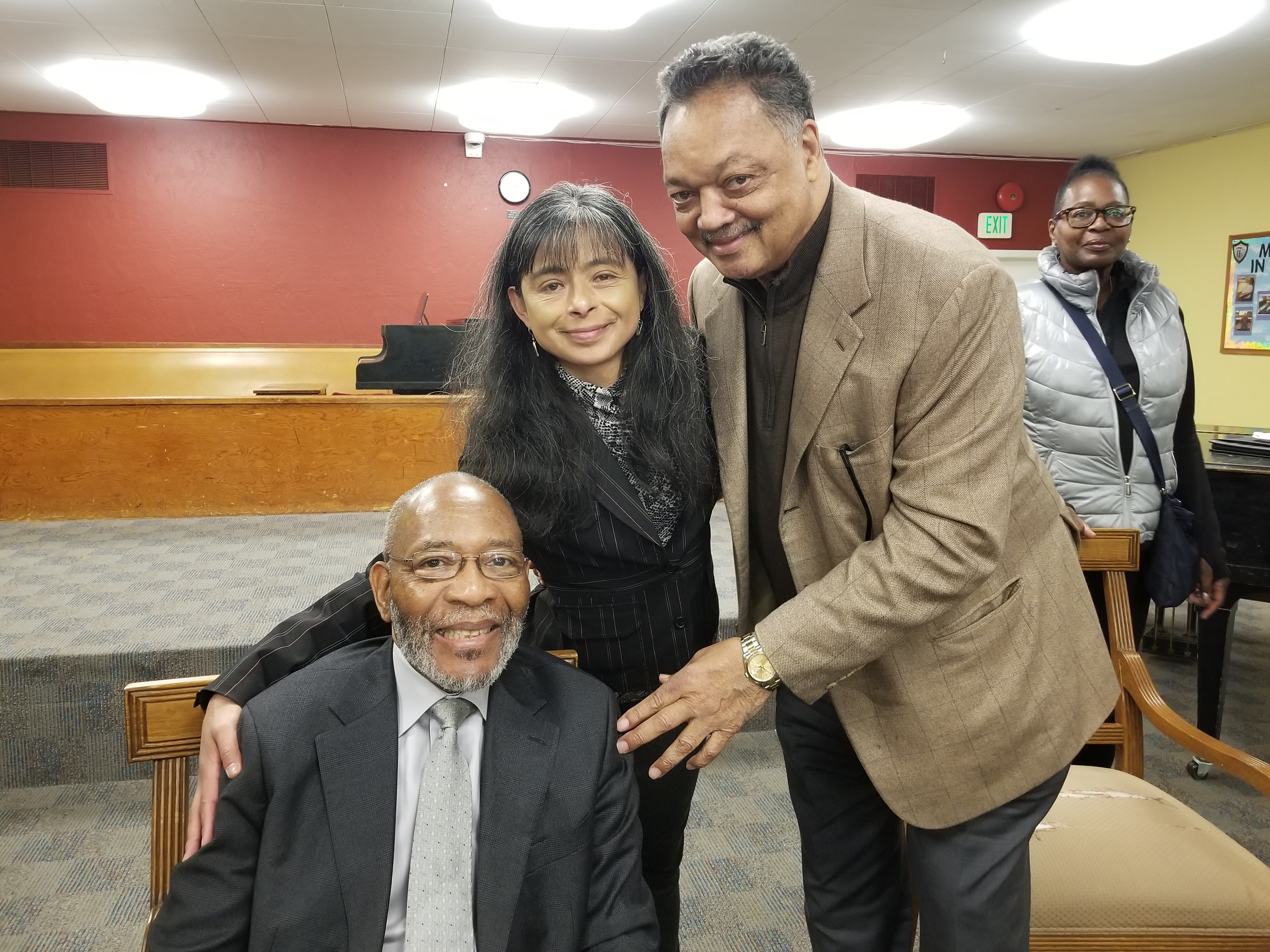 Catholic Charities CEO Jilma Meneses,  Rev. Dr. Amos Brown & Rev. Dr. Jesse Jackson stand with the Muslim community