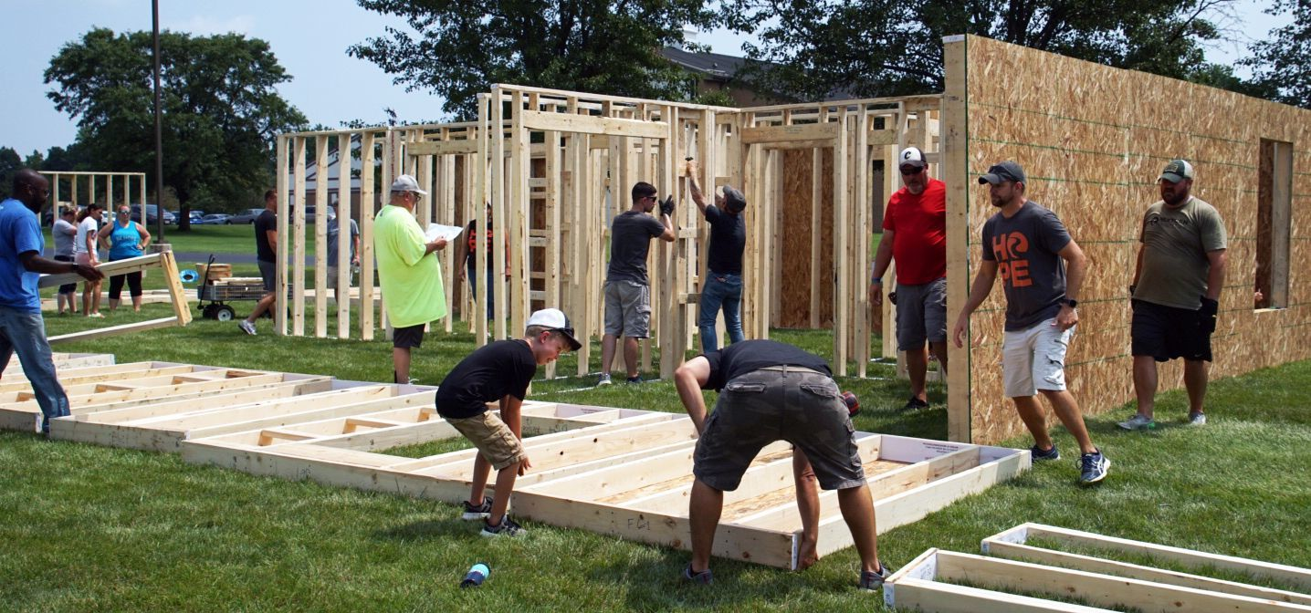 Volunteers from BeHope church build the walls for the home of a Dayton Habitat partner family.