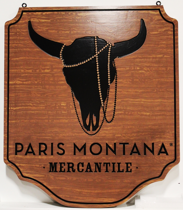 S28140 - Engraved High-Density-Urethane (HDU) Sign for Paris Montana Mercantile, with Bulls Head and Logo as Artwork and a Faux Wood Grain Painted Background