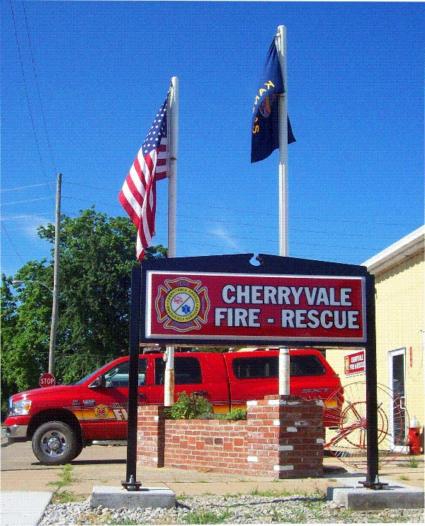 QP-1020 - Fire Department Badge on Entrance Sign of Cherryvale Fire Rescue Department, Kansas,  Artist Painted
