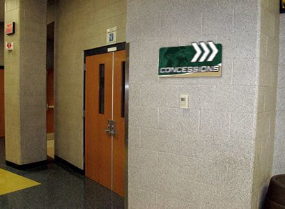 School hallway with concession sign arrow helping with school navigation, custom signs