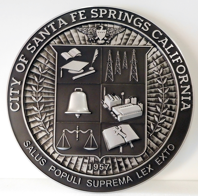 X3383-  Carved 3-D Wall Plaque of the Seal of the City of Sante Fe Springs, California, painted Metallic Silver with Hand-Rubbed Black Paint