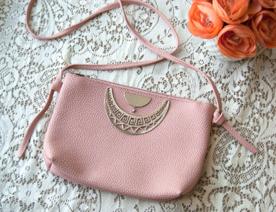 Add jewelry pieces to a thrifted clutch from Goodwill to make it your own.