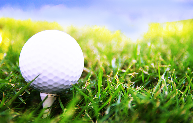 close up image of a golf ball on a tee