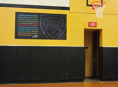 School gym with motivational saying with school logo, large custom signs