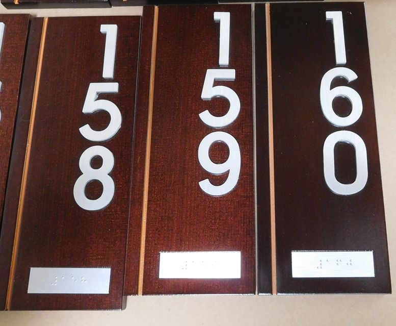 Y29183 - Carved Dark Stained Cedar Room Number Plaque with Aluminum Numbers and Braille Strips.