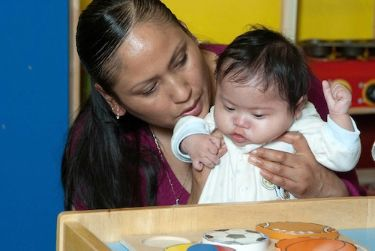 Infant with Down syndrome at therapy for early intervention.