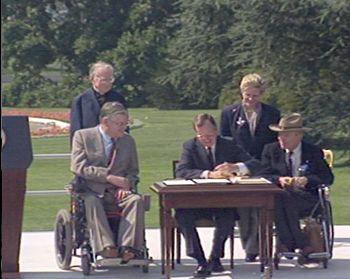 George Bush signing the ADA