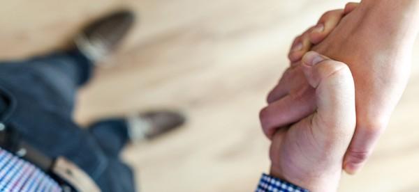 Person shaking customer's hand