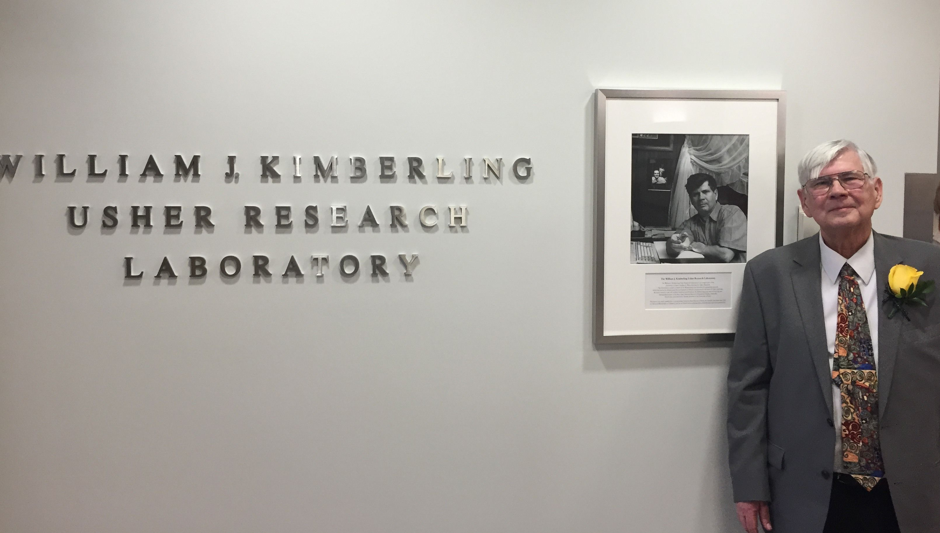 A picture of William J. Kimberling standing in front of his office for Usher Syndrome Research lab
