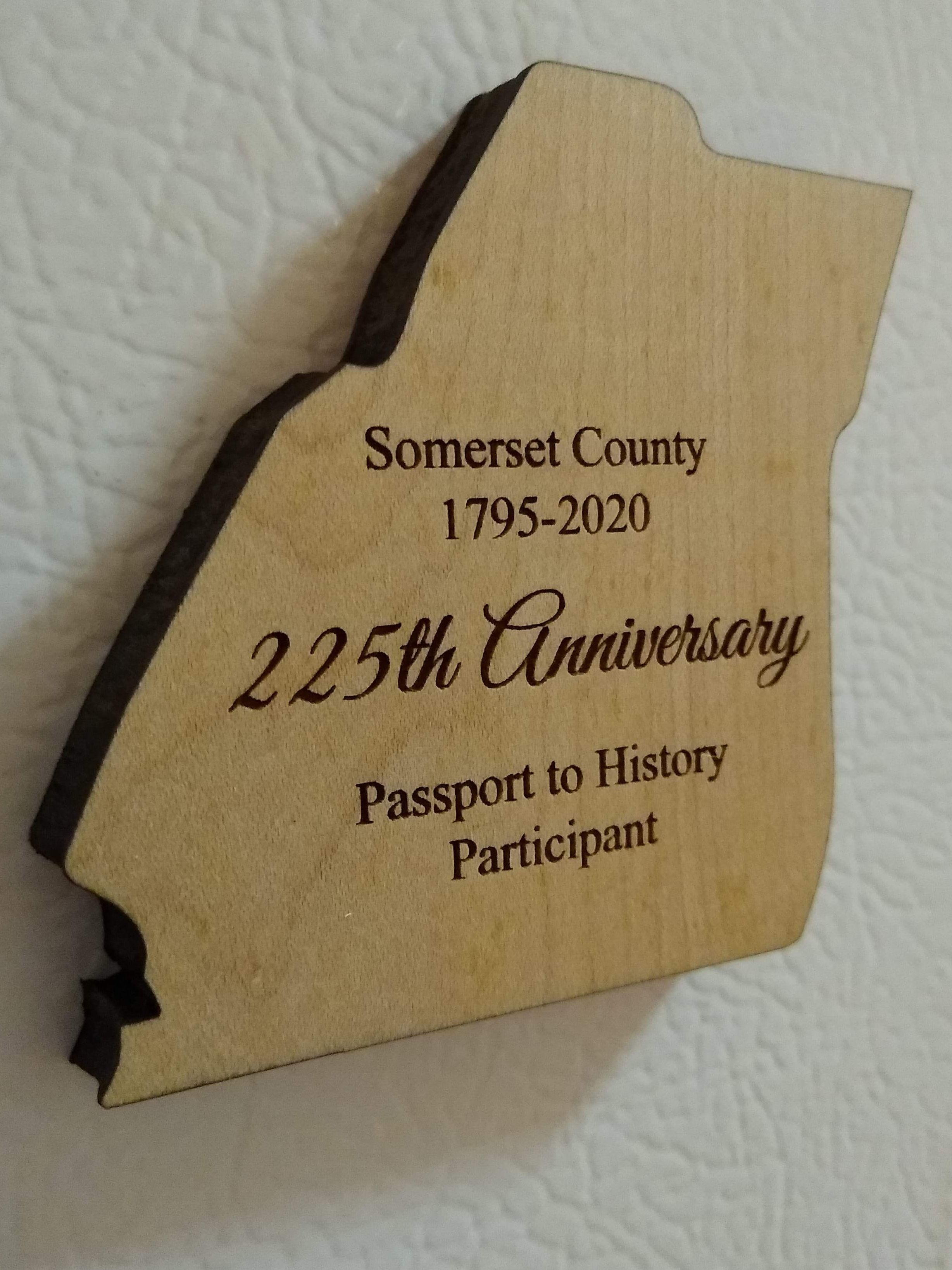 Laser cut keepsake shaped like the borders of Somerset County