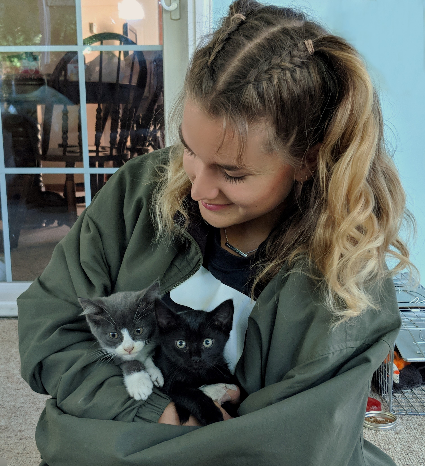 Tarina with the two kitties she rescued.