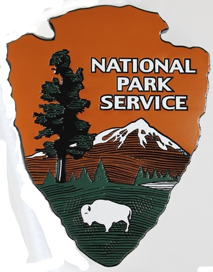 "AP-5682 - Carved and Engraved Cedar Wood Wall Plaque of the Logo of the US National Park Service, the ""Arrowhead"""