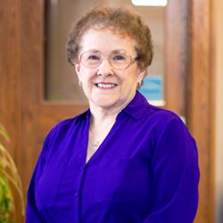 Jeanetta Schneider, Receptionist