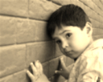 Child up against a wall