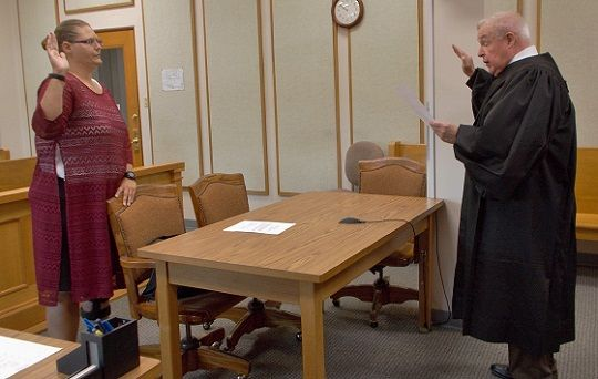 New CASA volunteer, Raylyn Latorra, being sworn in by Colfax County judge, The Honorable Patrick McDermott
