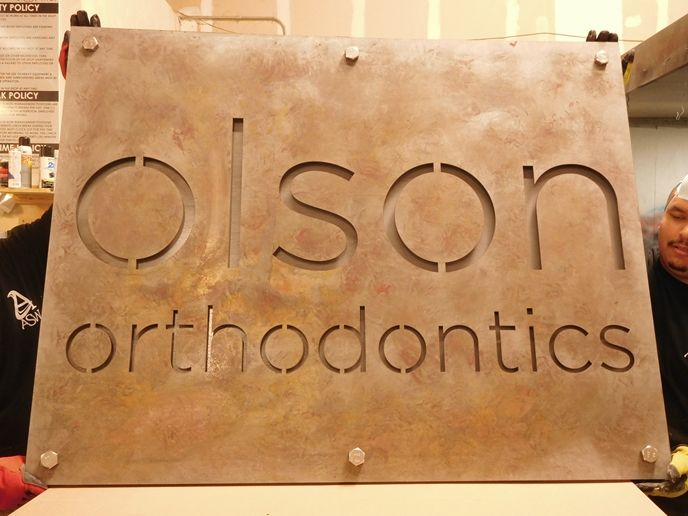 BA11539 - Weathering Steel Sign for Olson Orthodontics, with Cut-out Letters and Steel Backer Plate